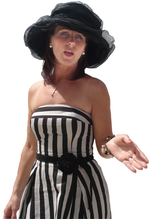 Loraine at the races, wearing an elegant black and white striped dress with a big-brimmed black hat.
